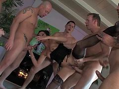 Black haired Danica Dillan with natural boobs and slim body in corset and stockings gets on knees and sucks Mark Wood, John Strong, Alex Gonz and Jenner in rough gang bang.