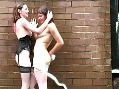 Two lewd girls wearing stockings are having fun outdoors. They kiss and fondle each other and then demonstrate their fingering skills to each other.
