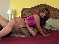 Sizzling brown-haired tranny Carmen Moore is having fun with some horny dude. The guy shows his rimjob skills to Carmen and then they have awesome multiposition sex.