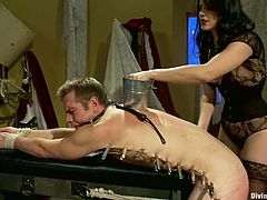 Bobbi Starr binds kinky stud John Jammen and attaches clothes pegs to his body. Then she humiliates and tortures the guy and destroys his asshole with a strapon.