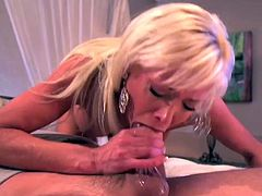 Mikki Lynn rides the cock of a bad-ass guy with a big beard in a parody after the Duck Dynasty. She makes sure he's ready for her pussy by sucking his dong before riding it.