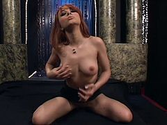 Adorable petite redhead Cytherea is having some good time indoors. She strokes her cute body ardently and then pounds her snatch with a rubber dildo.
