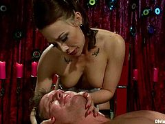 Amazing brunette mistress in sexy lingerie whips Parker London with a stick. Then he licks her feet and she toys him with a strap-on. After that she also rides his dick like a wild animal.