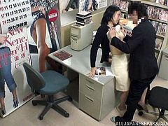 This Asian slut is going to suck cock and get fucked by two guys at the office and it's all recorded in security cam footage.