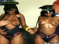 Curvy ebony chick Mia and her hot GF are having fun with two dudes. The hussies play with the men's schlongs and then jump on them and moan loudly with pleasure.