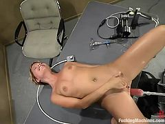 Kinky short-haired blonde Emily is having fun indoors. She strokes her tits and ass and then jumps on a fucking machine and moans with pleasure.