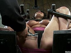 Chubby brunette Charley Chase is having a good time with some dude in a basement. She lets him put her into irons and then gets her cunt fingered and fucked with a dildo.