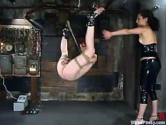 This kinky redhead enjoys being dominated and toyed while she's tied up. She really enjoys being the slave in this BDSM.
