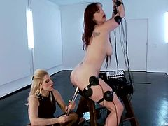 Submissive brunette girl gets tortured with electricity and then toyed deep in her pussy from behind by her blonde mistress.
