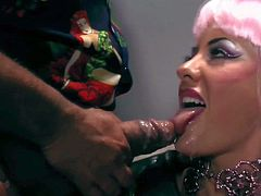 Cock loving whore Helly Mae Hellfire with colorful heavy make up and kinky wig dressed as Lady Gaga gets her pretty face sprayed with cum in close up during provocative parody.