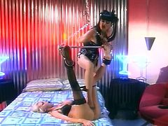 Submissive blonde girl licks her mistresses feet