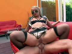 Cathy Campbell is s sinfully sexy blonde in shades. She gets her anal hole drilled by rock stiff cock with her sexy legs up. She enjoys butt fucking with her high heels on. Enjoy!