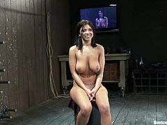 Captivating brunette Halie James is having fun with some guy in a cellar. She lets him chain her to a wall and then gets her coochie toyed to a strong orgasm.