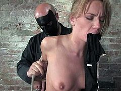 Salacious Holly Wellin is playing BDSM games with some dude. She gets bound and tormented and then enjoys having a dildo in her throbbing cunt.