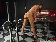 Sexy brunette is having fun indoors. She demonstrates and strokes her beautiful body and then takes an ardent ride on a fucking machine.