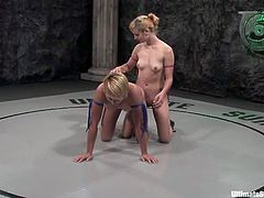 Stunning blonde chicks fight in a ring and Pinky Lee loses. So, she gets her vagina toyed rough in different poses right in the ring.