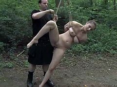 Master Abraham is having fun with beautiful chick called Sister Dee in a forest. Master binds and hangs Dee up and pleases her with some ardent tortures.
