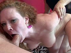 Curly haired redhead Audrey Hollander is an insatiable slut who loves to suck and fuck. This pale skinned honey with natural juicy tits and sexy ass gives blowjob and gets her pussy fucked hard and deep in sex action with two hot guys.