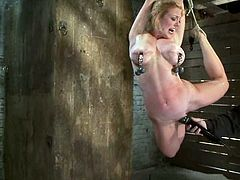 Hot blonde girl gets undressed and then tied up. After that Isis Love fingers her pussy and fixes claws to nipples.