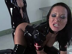Sexy brunette girl gets tied up and toyed with a vibrator by her mistress. Later on she also gets toyed hard and deep with an electric dildo.