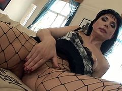 Nasty mature brunette in sexy lingerie rubs her cunt and sticks her toy in it before sucking this dudes cock . Then she gets his hard boner deep in her wet pussy