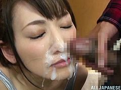 Kinky Japanese chick Saki Kouzai wearing a swimsuit is trying hard to satisfy two studs. She sucks and rubs their hard wangs and gets loads of jizz on her mouth and chin.