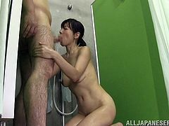 Horny Japanese bitch is getting naughty with her hubby in the bathroom. She sucks the dude's schlong and then leans against the wall and gets her vagina drilled from behind.