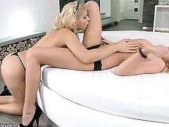Blonde and Brandy Smile have a lot of sexual energy to spend in lesbian action
