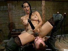 A guy called Blake is having fun with busty mistress Isis Love in a basement. He licks Isis's boots and lets her pull him by the balls and then gets his ass beaten with a stick.