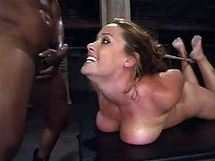 Amazing chick takes her lingerie off and get tied up. Then she also gets her tits clothespinned. Later on she gives a blowjob to a Black guy and gets fingered by him.