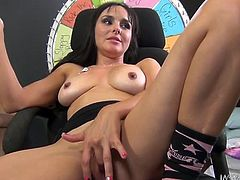 Cytherea is a horny brunette milf with fascinating body who has great appetite for sex. She reveals her appealing pair of boobs and fingers her cum-asking cunt while talking to her cameraman. Then she pushes a huge and curved dildo in her tight vagina which is making her moan and squirt as well.