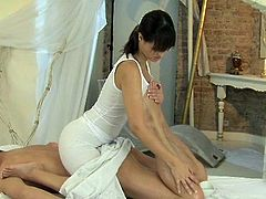 Charming brunette masseuse gives an amazing handjob and gets fucked deep in her oiled up pussy. Then she also gets her nice boobs cum covered.