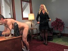 Blonde mistress Alexis Golden is gonna teach Jason Miller a good lesson. She beats his ass with a lash and then fucks him with a strapon on a desk.