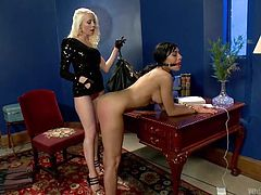 Beretta James is tied up and bent over the desk, so her cruel mistress Lorelei can spank her ass red. The blonde mistress uses all her strength, to beat her. Beretta is gagged, so she can't scream out in pain, or yell for help.