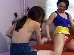 Check out two horny lesbian teenies having some fun together. First, they wrestle each other and once one give up she has to masturbate till a nice orgasm for you!