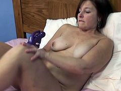 Hefty brunette slut with big boobs is wearing red fishnet top but nothing at the bottom. She inserts big sex toy in her pussy hole playing with herself.