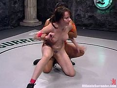 DragonLily and Dana Dearmond fight in Ultimate Surrender battle. White chick loses to an Asian. So, she gets her vagina licked and stuffed with a strap-on.