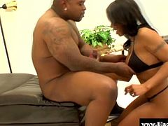 Busty ebony goddess Dee Rida ribs her black snatch on camera and wraps her lips around a big black cock, babe gets so damn wet that she bends over and gets her cunt nailed doggy style.