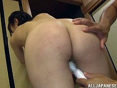 Titless Japanese chick Kaede Horiuchi is having fun with some guy indoors. She lets him play with her shaved cunt and then they fuck in cowgirl and missionary positions.