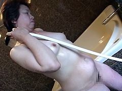 After she takes a bath, she is ready for some naughty things. Dude oils up her whole body and inserts pink dildo in her wet, hairy pussy till she is ready to cum/