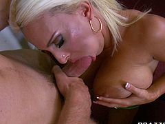 Lustful busty blonde gives her fuck buddy unforgettable blowjob and steamy tits job. she massages his dick with her massive impressive boobs.