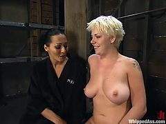 Brunette dominatrix Sandra Romain is playing dirty games with short-haired blonde Missy Monroe. Sandra binds Missy and decorates her body with clamps and clothespegs and then fucks her snatch with a strapon from behind.