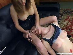 Audrey Leigh and Cloe Hart are getting naughty in awesome BDSM scene. Audrey puts a collar onto Cloe's neck and humiliates the skank before drilling her twat with a strapon.