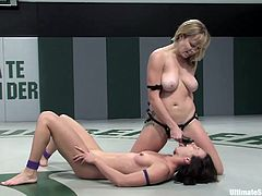 A couple of slutty chicks wrestle naked on the fuckin' floor and it's fuckin' sweet, check it out right here, it's hot as fuck!