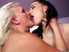 Blonde with huge knockers having lesbian fun with lesbian Judi
