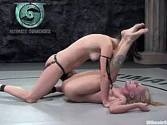 Bobbi Starr and Sarah Jane Ceylon fight in a ring showing great passion and skill. The blonde girl loses, so she gets her pussy drilled with a strap-on.