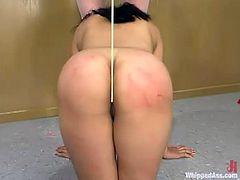 Kym Wilde is having some good time with Mika Tan in a classroom. She beats the Asian hottie with a stick and then drills her snatch wiht a strapon.