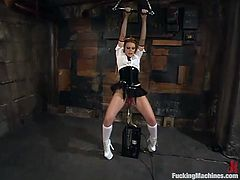 Gia Paloma poses in her sexy uniform and then gets tied up. After that she gets her pussy and ass toyed by the fucking machine. She also licks those dildos with pleasure.