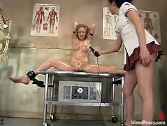 Gorgeous Anna Mills lies on a gynecological chair being tied up by kinky nurse in latex uniform. Anna gets her vagina stuffed with big dildo and tortured with electrodes.