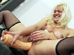 Check out this blonde bitch as she takes on some huge toys with her cunt. That hot love box is being stretched and punished for this action.